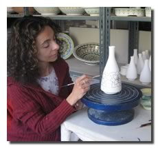 Paola painting a vase